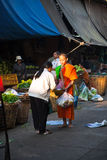 People donate food to the monk Royalty Free Stock Photo