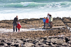 People on Doolin beach, county Clare, Ireland. Windy day at Doolin`s Bay, The Burren, County Clare, Ireland Stock Images