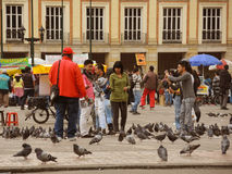 People and doves in the Bolivar Square. BOGOTA, COLOMBIA - AUGUST 24: People and doves in the Bolivar Square on August 24, 2013 in Bogota, Colombia Stock Photography