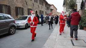 People dress as Santa play in Milan, Italy Stock Photography