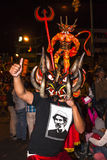 People dressed as devils dancing in the streets Royalty Free Stock Photos