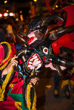 People dressed as devils dancing in the streets Stock Photo