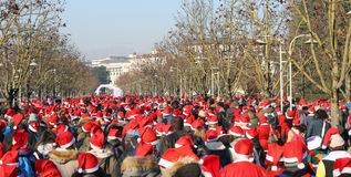 People dressed as Santa Claus during the foot race Royalty Free Stock Photos