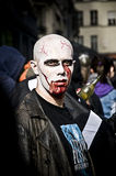 People dressed as a zombie parades on a street during a zombie walk in Paris. Royalty Free Stock Photo