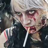 People dressed as a zombie parades on a street during a zombie walk in Paris. Stock Images