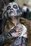 People dressed as a zombie parades on a street during a zombie walk in Paris. Royalty Free Stock Images