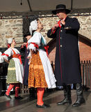People dressed in Czech traditional garb dancing and singing. The Folklore Ensemble Usmev (Smile) dressed in traditional Czech (Pilsen) garb dancing and singing stock image