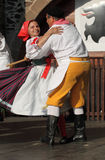 People dressed in Czech traditional garb dancing and singing. Stock Images