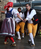 People dressed in Czech traditional garb dancing and singing. The Folklore Ensemble Usmev (Smile) dressed in traditional Czech (Pilsen) garb dancing and singing Stock Images