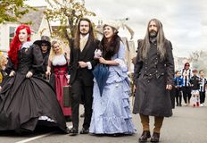 People dressed in fancy dress costume walking in a parade Royalty Free Stock Image