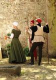 Medieval maiden and two men. People dressed in medieval costume Stock Images