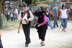 People dressed in medieval costumes. KENOSHA, WI - SEPTEMBER 4: People dressed in medieval costumes at the annual Bristol Renaissance Faire on September 4, 2010 Stock Photo