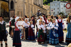People dressed in medieval costumes  wait for the start of the parade. People dressed in medieval costumes  at the beginning of the Burghausen Burgfest Festival Royalty Free Stock Photos