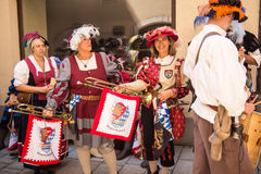 People dressed in medieval costumes wait for the start of the parade. Musicians dressed in medieval costumes wait for the start of the parade at the beginning of Royalty Free Stock Photos