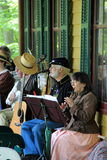 People dressed in period clothes,playing in concert,Grant Cottage, Saratoga New York,2014 Stock Photos