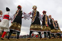 People dressed with traditional Bulgarian authentic folklore clothes dance Bulgarian horo
