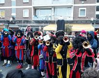 24-November-2018, The Hague, Netherlands, Europe. Celebrating the arrival of Dutch Saint Nicholas, called Sinterklaas, with his as. People dressed up in costume royalty free stock images
