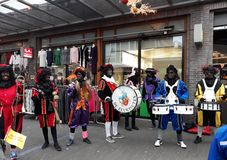 24-November-2018, The Hague, Netherlands, Europe. Celebrating the arrival of Dutch Saint Nicholas, called Sinterklaas, with his as. People dressed up in costume stock image