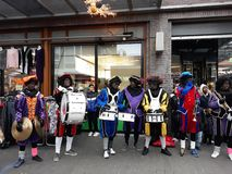 24-November-2018, The Hague, Netherlands, Europe. Celebrating the arrival of Dutch Saint Nicholas, called Sinterklaas, with his as. People dressed up in costume royalty free stock photo