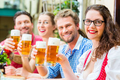 People drinking beer in Bavarian restaurant or pub Stock Photography