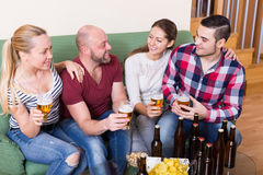 People drinking beer  and laughing Royalty Free Stock Photography