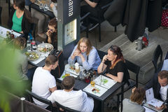 People drinking beer outside the Southbank center. Stock Image
