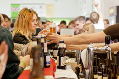 People drinking and buying beer again in crowd of customers Royalty Free Stock Photos