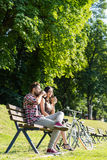 People drinking coffee in park Royalty Free Stock Photo
