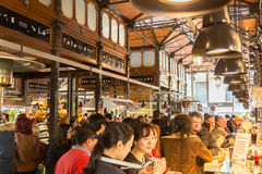 People drinking and eating at San Miguel market, Madrid. Royalty Free Stock Image
