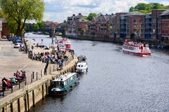 People drinking by the edge of River Ouse, York Royalty Free Stock Image