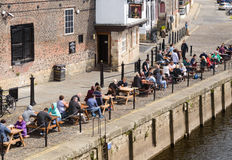 People drinking by the edge of River Ouse, York Royalty Free Stock Photography