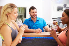 People drinking protein shakes at the fitness bar in a gym Royalty Free Stock Images