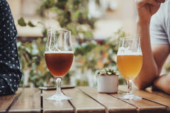 People Drinking. Two People Drinking Beer Outdoors Stock Photography