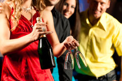 People with drinks in bar or club Stock Photos