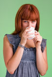 People, drinks and leisure concept, happy young woman with cup of tea Royalty Free Stock Photo