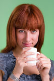 People, drinks and leisure concept, happy young woman with cup of tea Royalty Free Stock Image