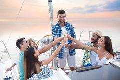 People with drinks on yacht. Royalty Free Stock Photography