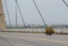 People driving on Binh bridge with cloudy sky Stock Photos