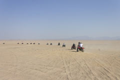 People driving fourwheelers in Hurghada desert Stock Image