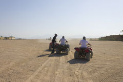 People driving fourwheelers in Hurghada desert Royalty Free Stock Photos