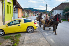 People driving horse cart. Romania Royalty Free Stock Images