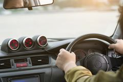 People driving on racing sport car performance with handle steering royalty free stock images
