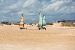 People driving sand yachting on the beach. They are learning and having fun Stock Images