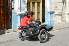 People driving a sidecar bike at Santiago de Cuba Royalty Free Stock Images