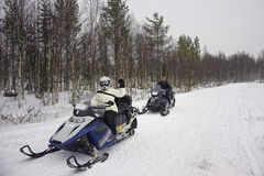 People driving a snowmobile in Ruka in Lapland Royalty Free Stock Photo