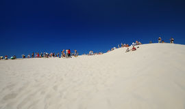 People on dune royalty free stock photos