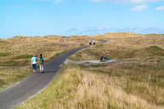 People in dunes of national park on Texel island, Netherlands Stock Photos