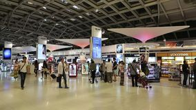 People in duty free area inside Bangkok international airport in Thailand stock video footage