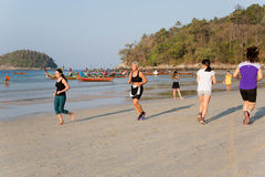 People in the early morning on the Kata beach Stock Photography