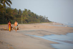 People early in the morning walking on the beach. PALOMINO, COLOMBIA, JANUARY 18: Unidentified couple of Colombian people early in the morning walking on the Stock Photography
